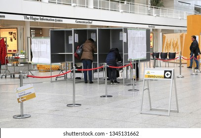The Hague, The Netherlands - March 20, 2019: People are voting in city hall in the Hague for the Provicial and Waterboard elections on march 20, 2019