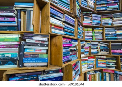THE HAGUE, NETHERLANDS, MAY 14: Old used books on sale in small wooden cases stacked in outdoors flea market in The Hague. Netherlands 2016