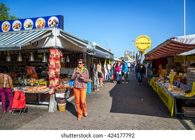 The Hague, Netherlands - May 15th 2014 - Young lady walking in a public market in The Hague in Netherlands