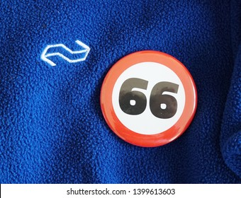 The Hague, the Netherlands. May 2019. Logo of the Dutch national railway (NS, or Nederlandse Spoorwegen) and button with number 66. Public transport in the Netherlands will be on strike in may 2019.