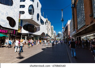 THE HAGUE, NETHERLANDS - MAY 26, 2017: View of the shopping street Grote Marktstraat in the city center of The Hague on May 26, 2017. Its a popular district for shopping and contains big stores.