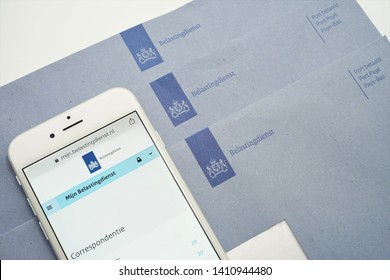 The Hague, The Netherlands - May 29, 2019: Dutch Tax authority (Belastingdienst) correspondence, digital mailbox will eventually replace the blue envelope