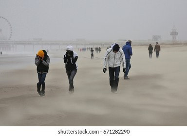 The Hague, The Netherlands - November 11, 2016: People on the beach in stormy weather