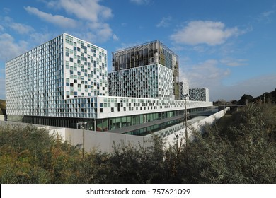 The Hague, Netherlands - November 3, 2017: The new 2016 opened International Criminal Court building with moat, located between dunes in The Hague.