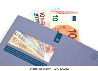 The Hague, The Netherlands - November 9, 2015: Euro notes on a blue envelope of the Dutch Tax Authorities