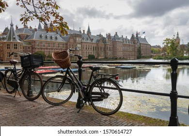 The Hague, Netherlands - October 3, 2017: Cityscape of Den Haag (the Hague) with the historic Binnenhof houses of the parliament along the Hofvijver with bicycles in the foreground, Netherlands