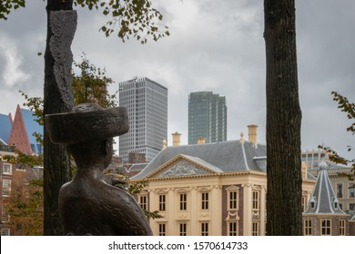 The Hague, Netherlands - October 3, 2017: Statue of Haagsche Jantje at the Hague Hofvijver pointing towards Mauritshuis in Den Haag (the Hague), Netherlands