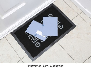 The Hague, The Netherlands - October 5, 2013: Blue envelopes of the dutch tax office on the doormat