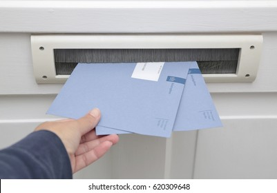 The Hague, The Netherlands - October 5, 2013: Blue envelopes of the dutch tax office in the mailbox