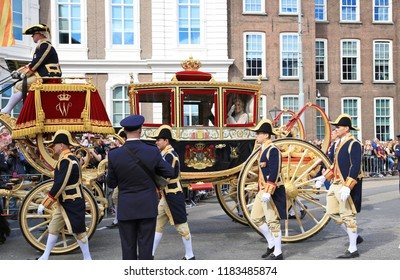 The Hague, The Netherlands - September 18, 2018: The glass carriage with Queen Maxima and King Willem-Alexander waving to the crowd on Prinsjesdag, the official opening of parliament