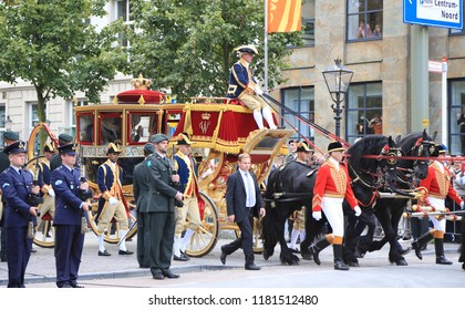 The Hague, The Netherlands - September 20, 2016: The glass carriage with Queen Maxima and King Willem-Alexander waving to the crowd on Prinsjesdag, the official opening of parliament