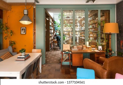 HAGUE, THE NETHERLANDS: Small cozy cafe with bookshop and antique stained-glass windows, couch and tables for coffee of readers on April 6 2018. Hague is one of major cities hosting the United Nations