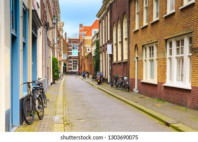 Hague, Netherlands street view with traditional dutch houses and bicycles in Holland