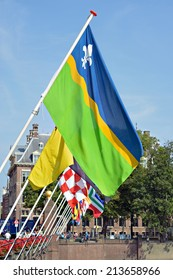 HAGUE, NETHERLANDS-AUGUST 01, 2014: Historical centre of Hague near lake Hofvijver with flags of provinces, Netherlands. This is one of mostly popular sites for tourists in the city