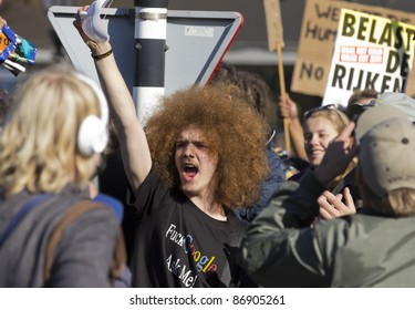 THE HAGUE - OCTOBER 15: An unidentified young man raises his anonymous mask and shouts at the police during the Occupy protest on October 15, 2011 in The Hague, The Netherlands.