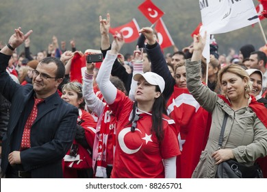 THE HAGUE - OCTOBER 30: Unidentified men and women of Turkish origin making the Grey Wolves hand sign during a protest against the Kurdistan Workers Party on October 30, 2011 in The Hague.