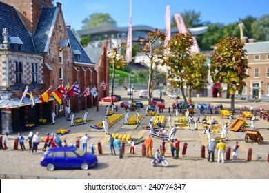 HAGUE - SEPTEMBER 19: Scaled replica of Alkmaar Cheese Market at Madurodam minature park, taken on September 19, 2014 in Hague, Netherlands
