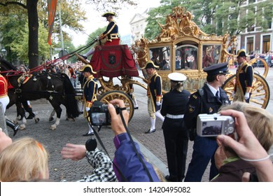 The Hague, South Holland, The Netherlands, September 15, 2009. People were gathering alongside the street and taking photos when Queen Beatrix on the golden carriage was passing by at Prinsjesdag.