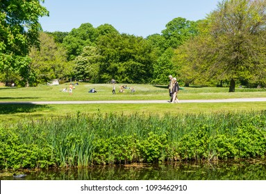 The Hague,Holland,11-May-2018:people relax on the grass field in the city park Clingendael, the park Clingendael is in the hague in Holland, this park is open around the year and famous of flowers