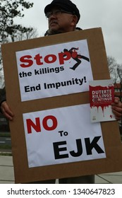The Hague/Netherlands-March 16, 2019: Human rights advocates rally in front of the International Criminal Court in The Hague, March 16, 2019 the day before the withdrawal of the Philippines  from ICC.
