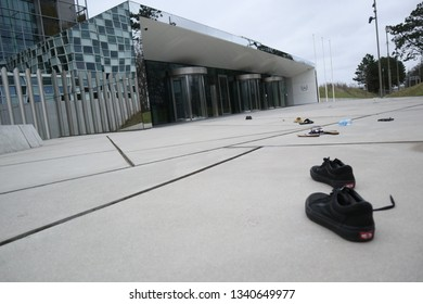 The Hague/Netherlands-March 16, 2019: Slippers and shoes,as symbol of victims of killings, are laid in front of the International Court the day before the pullout of the Philippines  from ICC.