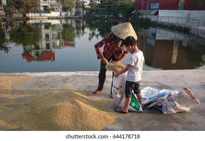 HAI DUONG, VIET NAM, 21 May 2017 children, rural Hai Duong, Vietnam, playing outdoors with rice