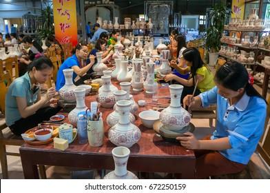HAI DUONG, VIET NAM, July 5, 2017 Ceramic workers of traditional ceramics Chu Dau, Nam Sach, Hai Duong, Vietnam