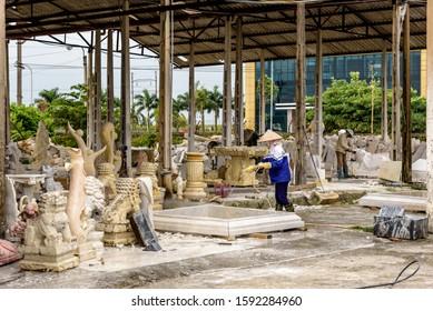 HAI DUONG, VIETNAM - November 17,2019: Disabled People Stone Craving Sculpting Statues for Sale at the Hong Ngoc Fine Art Center Workshop Near Hanoi Vietnam