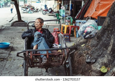 """Hai Phong, Vietnam - 12/02/2017: The old man and his cyclo. Cyclo (pronounced as """"Xich Lo"""") was the most popular transportation means in Vietnam in the past."""