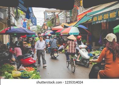 HAI PHONG, VIETNAM - NOVEMBER 12, 2018: People at busy morning street in Hai Phong, Vietnam.