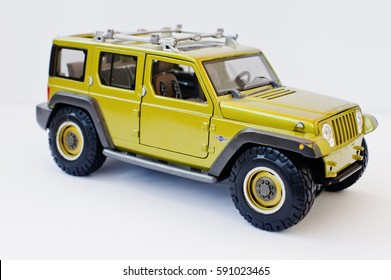 Hai, Ukraine - March 1, 2017: Mini copy of green toy car Jeep Wrangler isolated on white background.