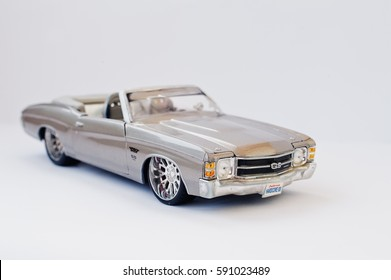 Hai, Ukraine - March 1, 2017: Mini copy of silver toy lowrider car 1968 Chevrolet Camaro SS 350 Convertible isolated on white background.