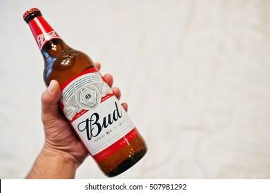 Hai, Ukraine - October 15, 2016: Man hold on hand beer bottle of Bud, kings of the beer