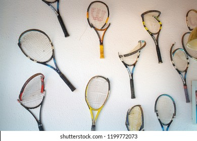 Haid, Austria, August 01, 2018: broken tennis rackets wilson and babolat hang on the wall of the tennis club