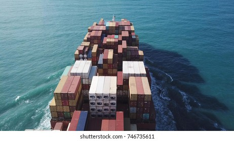 Haifa, Israel - 01 Nov, 2017: large ULCV container ship underway, sails on open water fully loaded with containers and cargo - close view of the bridge