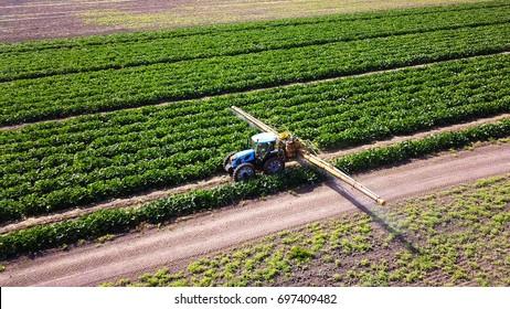 Haifa, Israel - 15 Aug, 2017: Agricultural Sprayer - Tractor sprays water or fertilizer - irrigation