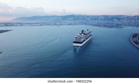 Haifa, Israel - 4 Nov, 2017:Aerial view of arrival of luxury cruise ship at port in early morning right after sunrise, view of swimming pool and deck - the CELEBRITY CONSTELLATION