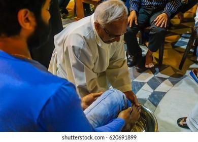 HAIFA, ISRAEL - APRIL 13, 2017: Washing of the feet ceremony, on Holy Thursday, part of Easter celebration, in the Church of Stella Maris Carmelite Monastery (Our Lady of Mount Carmel), Haifa, Israel
