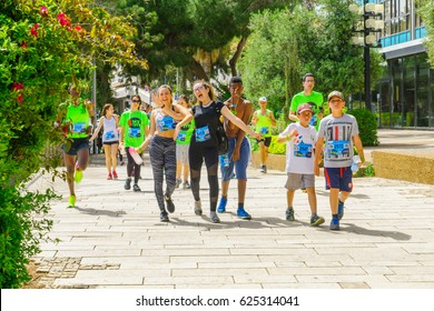 HAIFA, ISRAEL - APRIL 21, 2017: Runners participate in a popular running event for charity causes (zau larutz, get out and run) in the public streets of Haifa, Israel
