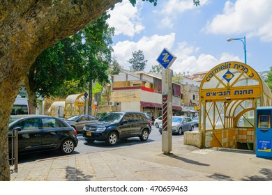 HAIFA, ISRAEL - AUGUST 18, 2016: Scene of Masaryk square in Hadar HaCarmel district, with the Carmelit subway station, local businesses, locals and visitors, in Haifa, Israel