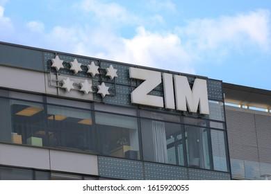 HAIFA, ISRAEL- December 21, 2019:  ZIM Logo. ZIM sign on the office building in Haifa high tech zone.