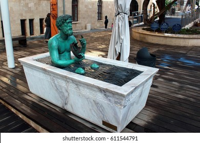 HAIFA, ISRAEL - DECEMBER 5,2013: Statue of Archimedes in a bathtub, demonstrating principle of buoyant force. Located at Madatech, Israel's National Museum of Science, Technology, and Space.
