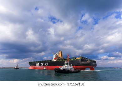 Haifa, Israel - February 2, 2016: MSC mega container ship pulled by a tag boat into Haifa's commercial port.