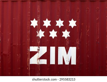 Haifa, Israel - July 10, 2015: ZIM logo on a container. ZIM Israel Navigation Company Ltd. and Zim American Israeli Shipping Inc.  is the biggest cargo shipping company in Israel.