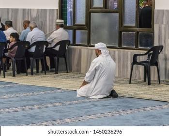 Haifa, Israel, July 11, 2019 : Muslim believers pray in prayer room of the Ahmadiyya Shaykh Mahmud mosque in Haifa city in Israel
