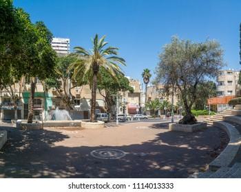 HAIFA, ISRAEL - JUNE 09, 2018: The Binyamin garden, fountain and Nordau street, with locals, in Hadar HaCarmel neighborhood, Haifa, Israel