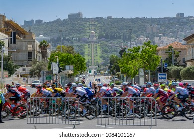 HAIFA, ISRAEL - MAY 05, 2018: Scene of stage 2 of 2018 Giro d Italia, with cyclists and spectators, and the German Colony, Bahai gardens and shrine in the background. Haifa, Israel