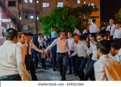HAIFA, ISRAEL - MAY 13, 2017: A group of ultra-orthodox Jews dance, as part of the Lag BaOmer holiday celebration, in Haifa, Israel