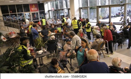 HAIFA, ISRAEL, NOVEMBER 24th, 2016: Elderly people evacuated by police and taken to public shelters in Haifa, Romema, Israel.