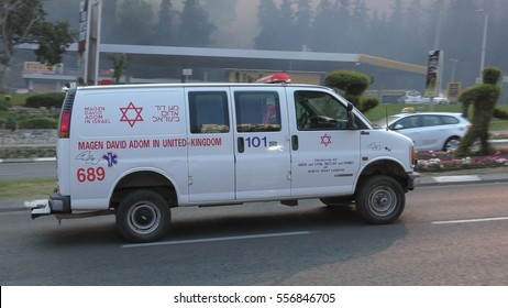 HAIFA, ISRAEL, NOVEMBER 24th, 2016: MDA Magen David Adom Ambulance drives to headquarter or hospital during fires in Haifa.